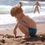 Little boy play on the beach Royalty Free Stock Photo