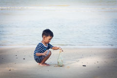 Little boy play at the beach Royalty Free Stock Photography