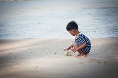 Little boy play at the beach Stock Photos