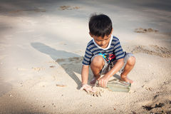 Little boy play at the beach Stock Image