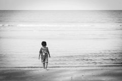 Little boy play at the beach Stock Images