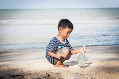 Little boy play at the beach Royalty Free Stock Image