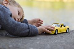 Little boy play with a car Royalty Free Stock Images