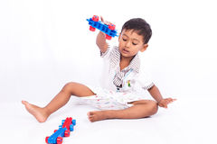 Little  boy play car plastic toy Royalty Free Stock Photo