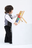 Little boy play with colorful abacus Stock Images