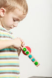 Little boy play with colorful toy. Stock Images