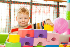 Little boy play construction set. Little boy play colourful construction set Stock Photography