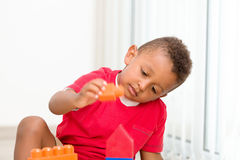 Little boy play construction set Stock Images