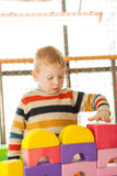 Little boy play construction set. Preschooler boy play construction set Stock Photography