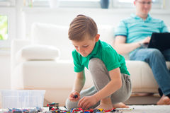 Little boy play, father works with laptop Royalty Free Stock Photography