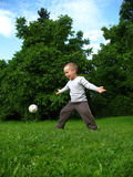 Little Boy Play Football Stock Images