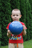 Little boy play football Stock Photo