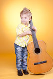 Little boy play the guitar Stock Photo