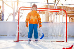 Little boy play hockey standing in gates Royalty Free Stock Image