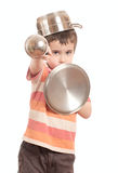 Little boy play knight with kitchen Stock Photos