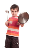 Little boy play knight with kitchen Stock Images