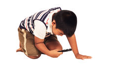 Little boy play magnifying Stock Image