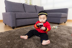 Little boy play with mobile phone Royalty Free Stock Photo
