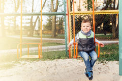 Little boy play on playground with blur park background Royalty Free Stock Photography