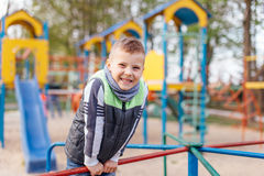 Little boy play on playground with blur park background Royalty Free Stock Photos