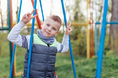 Little boy play on playground with blur park background Royalty Free Stock Photo