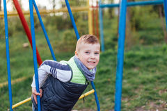 Little boy play on playground with blur park background Stock Photography