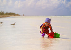 Little boy play with sand on beach Stock Photography