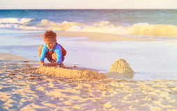 Little boy play with sand on beach Royalty Free Stock Photography