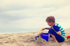 Little boy play with sand on beach Royalty Free Stock Photos