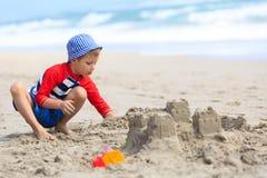 Little boy play with sand on summer beach Royalty Free Stock Photos