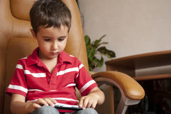 Little boy play smartphone game Stock Photography
