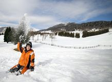 Little boy play with snow in the mountains Stock Photography