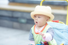 Little boy play soap bubbles. Portrait of little baby boy in stroller playing soap bubbles Stock Image