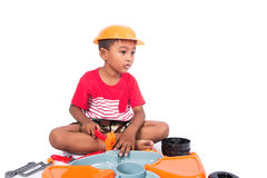 Little boy play tool plastic toy on white background Stock Photos