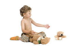 Little boy play toy bear Royalty Free Stock Photography