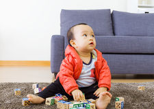 Little boy play toy block Stock Image