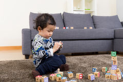 Little boy play toy block. At home Stock Photos