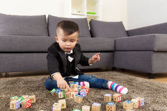 Little boy play toy block Stock Image