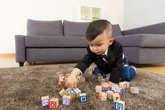 Little boy play toy block Stock Photos