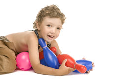 Little boy play toy skittles Stock Photography