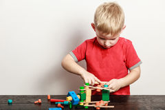 Little boy play with toy on table. Stock Photos