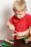 Little boy play with toy on table. Spending free time play and education for children. Little boy in red shirt play with colorful toy on table Stock Images