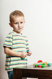 Little boy play with toy on table. Royalty Free Stock Photography