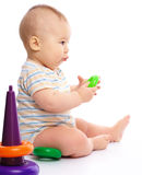 Little boy play with toys Stock Images