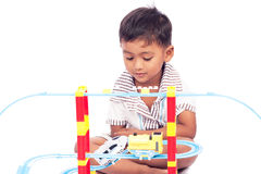 Little boy play train toy Stock Images