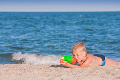 Little boy play with water gun 5 Stock Photos