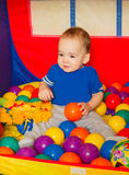 The little boy played with colored balls Royalty Free Stock Photography