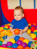 The little boy played with colored balls Royalty Free Stock Photos