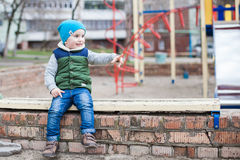 Little boy on playground Stock Photos