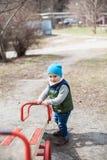 Little boy on playground Stock Image